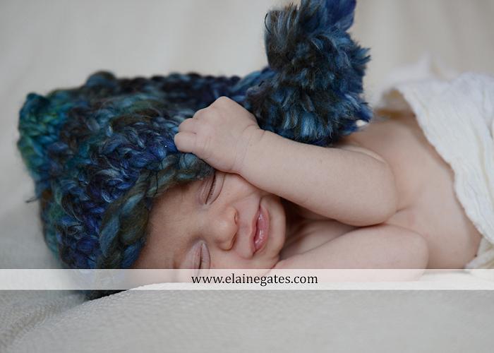 Mechanicsburg Central PA newborn baby portrait photographer girl sleeping indoor blanket sister mother jm 05