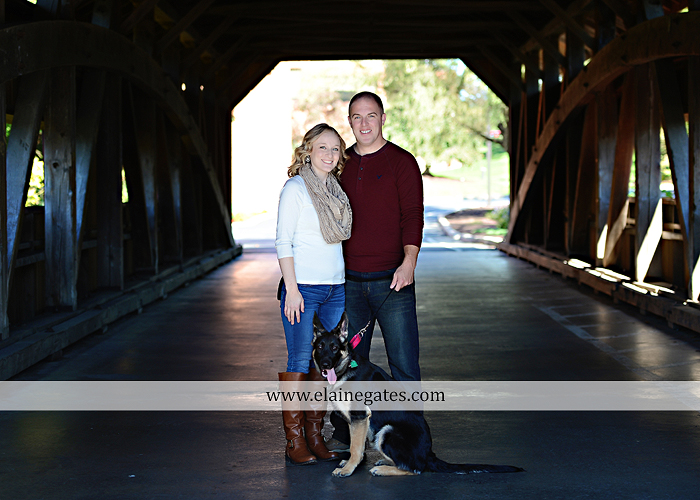 Mechanicsburg Central PA portrait photographer maternity outdoor leaves water stream creek dog pumpkin covered bridge path woods trees kiss expecting mc 3