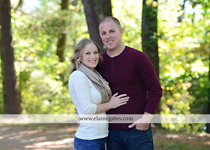 Mechanicsburg Central PA portrait photographer maternity outdoor leaves water stream creek dog pumpkin covered bridge path woods trees kiss expecting mc 4