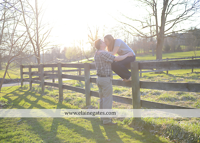 Mechanicsburg Central PA engagement portrait photographer outdoor road fence water steam creek trees sunset motorcycle harley-davidson holding hands kiss cf 02