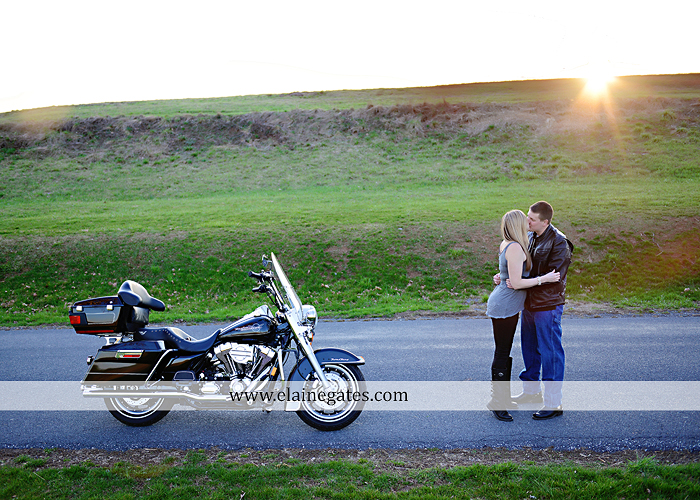 Mechanicsburg Central PA engagement portrait photographer outdoor road fence water steam creek trees sunset motorcycle harley-davidson holding hands kiss cf 09