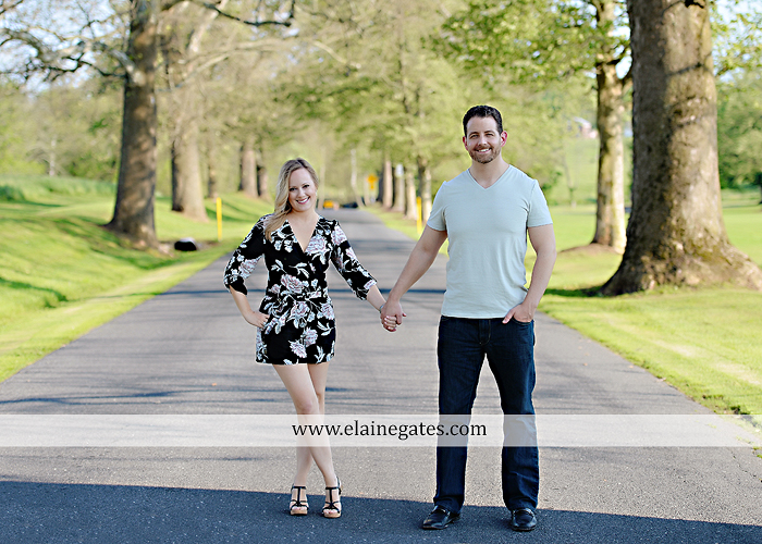 Mechanicsburg Central PA engagement portrait photographer outdoor road field trees water stream creek fence holding hands hug kiss at 1