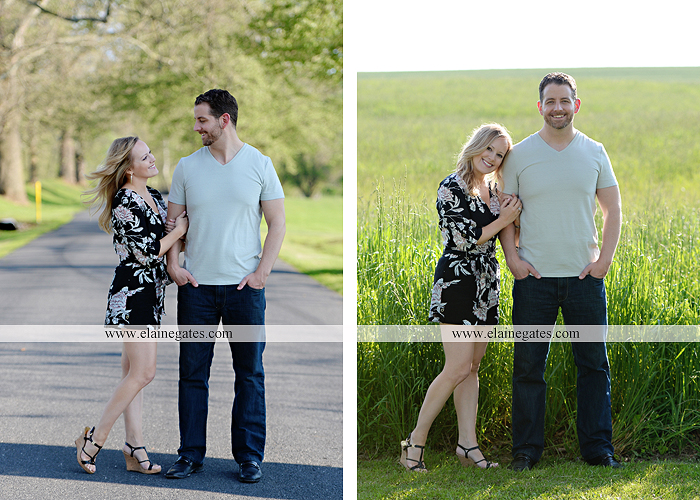 Mechanicsburg Central PA engagement portrait photographer outdoor road field trees water stream creek fence holding hands hug kiss at 2