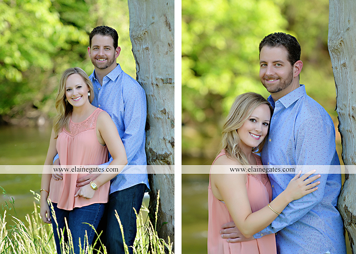 Mechanicsburg Central PA engagement portrait photographer outdoor road field trees water stream creek fence holding hands hug kiss at 6