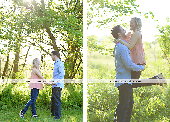 Mechanicsburg Central PA engagement portrait photographer outdoor road field trees water stream creek fence holding hands hug kiss at 9