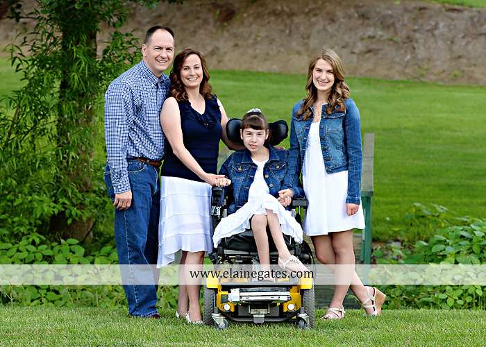 Mechanicsburg Central PA family portrait photographer outdoor children daughters sisters mother father grass trees road wheelchair hug kiss dk 07
