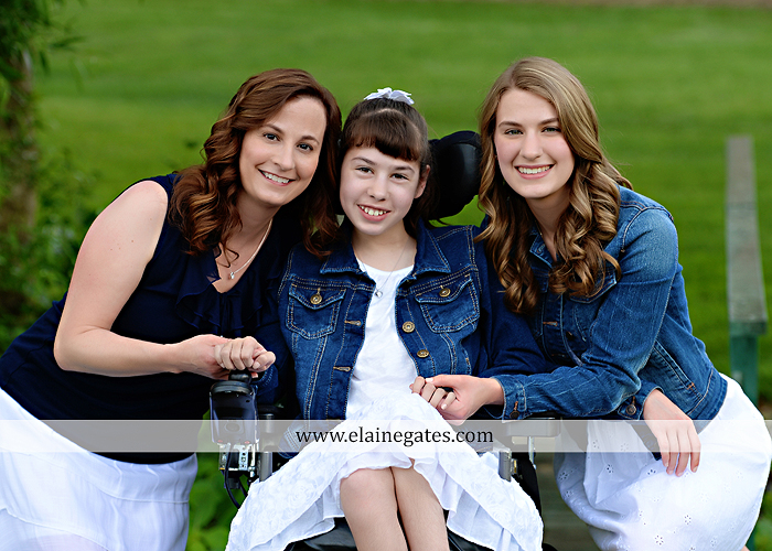 Mechanicsburg Central PA family portrait photographer outdoor children daughters sisters mother father grass trees road wheelchair hug kiss dk 08