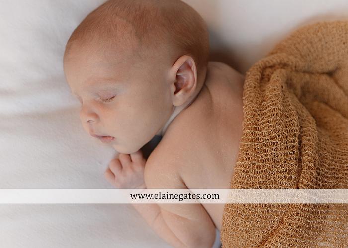 Mechanicsburg Central PA newborn baby portrait photographer boy sleeping blanket knit hat foot hand father dad mom mother kiss mb 03