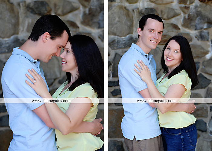 Mechanicsburg Central PA engagement portrait photographer hotel hershey outdoor steps stairs dog grass stone wall pillars hug kiss holding hands fountain water indoor balcony nr 03