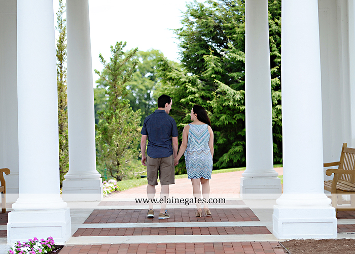 Mechanicsburg Central PA engagement portrait photographer hotel hershey outdoor steps stairs dog grass stone wall pillars hug kiss holding hands fountain water indoor balcony nr 08