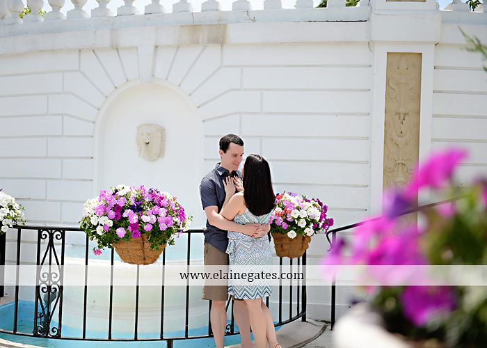 Mechanicsburg Central PA engagement portrait photographer hotel hershey outdoor steps stairs dog grass stone wall pillars hug kiss holding hands fountain water indoor balcony nr 11