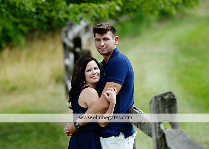 Mechanicsburg Central PA engagement portrait photographer outdoor orchard vineyard trees wildflowers fence field wood wall hug kiss holding hands mustang car aw 05