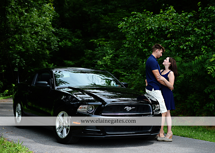 Mechanicsburg Central PA engagement portrait photographer outdoor orchard vineyard trees wildflowers fence field wood wall hug kiss holding hands mustang car aw 11