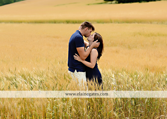 Mechanicsburg Central PA engagement portrait photographer outdoor orchard vineyard trees wildflowers fence field wood wall hug kiss holding hands mustang car aw 13
