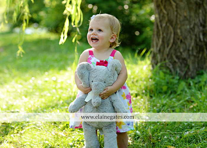 Mechanicsburg Central PA baby child portrait photographer girl outdoor family mom dad daughter road trees grass kiss stuffed animal field jt 6