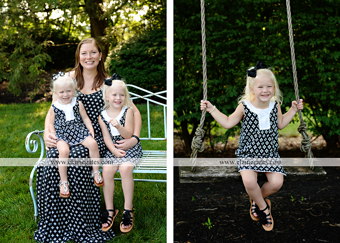 mechanicsburg-central-pa-family-portrait-photographer-outdoor-father-mother-daughters-sisters-siblings-iron-bench-wooden-swing-wildflowers-grass-holding-hands-hug-kw-02