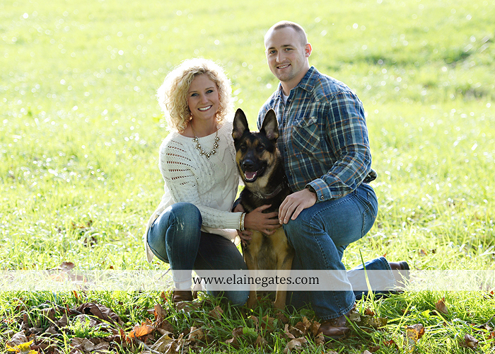 mechanicsburg-central-pa-engagement-portrait-photographer-outdoor-couple-love-hug-kiss-ring-holding-hands-road-field-hay-bale-sunset-tree-fence-water-creek-stream-shore-dog-wildflowers-ce02