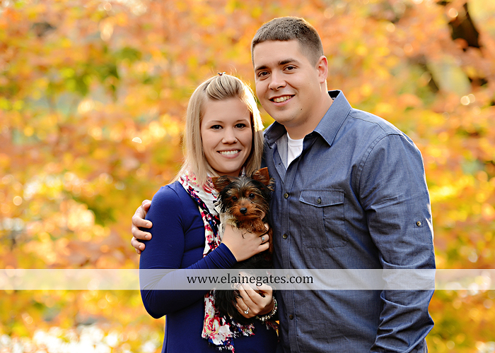 Mechanicsburg Central PA portrait photographer engagement outdoor fall leaves trees couple hug embrace kiss dog covered bridge holding hands field date rocks mpck 1