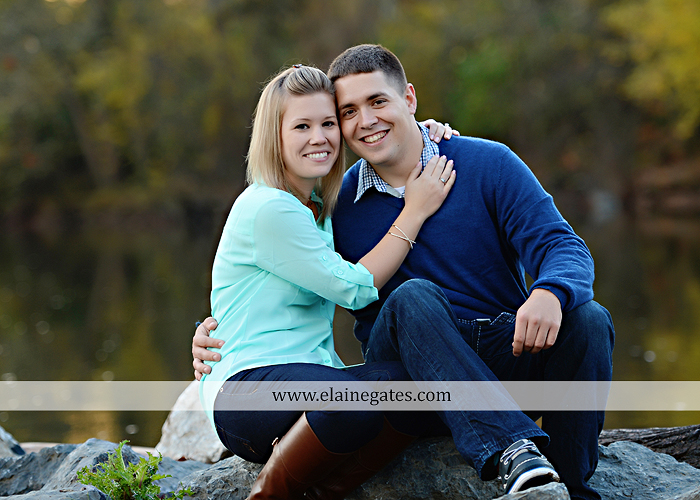Mechanicsburg Central PA portrait photographer engagement outdoor fall leaves trees couple hug embrace kiss dog covered bridge holding hands field date rocks mpck 12