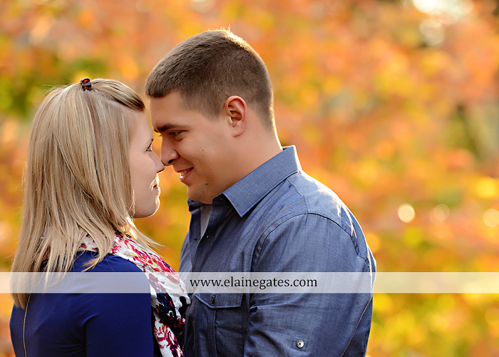 Mechanicsburg Central PA portrait photographer engagement outdoor fall leaves trees couple hug embrace kiss dog covered bridge holding hands field date rocks mpck 2