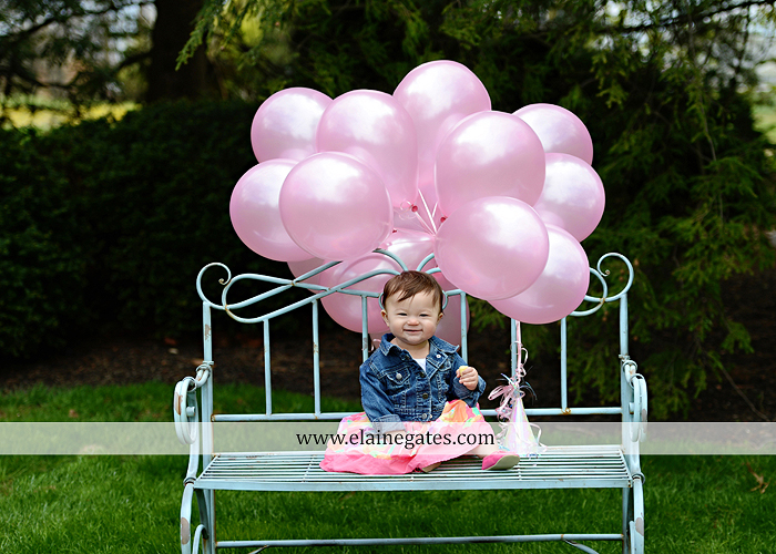 Mechanicsburg Central PA portrait photographer first birthday girl daughter family parents mother father chair bench balloons banner hug walk grass trees flowers mv 3