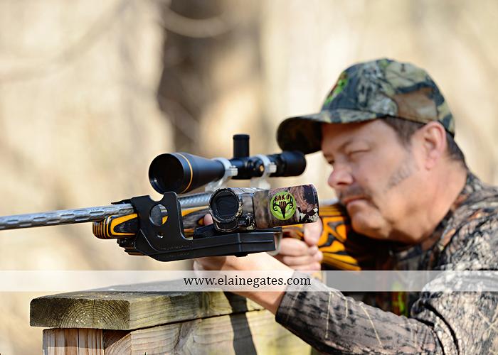 Mechanicsburg Central PA portrait photographer outdoor RAK'D UP gun rifle bow weapons camera mount trees woods camouflage brush rm 1