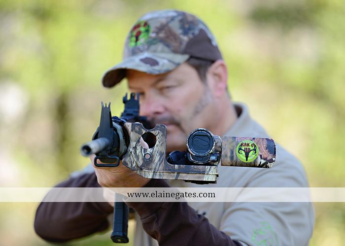 Mechanicsburg Central PA portrait photographer outdoor RAK'D UP gun rifle bow weapons camera mount trees woods camouflage brush rm 2