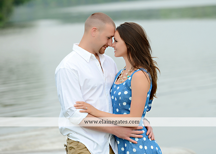 Mechanicsburg Central PA portrait photographer engagement outdoor couple water trees grass field dock water lake fishing lure boat holding hands picnic basket kiss path ph 05