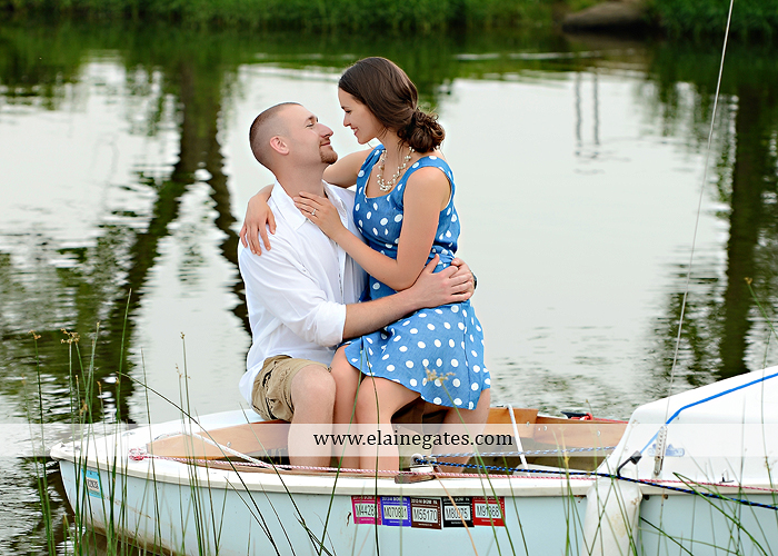 Mechanicsburg Central PA portrait photographer engagement outdoor couple water trees grass field dock water lake fishing lure boat holding hands picnic basket kiss path ph 10
