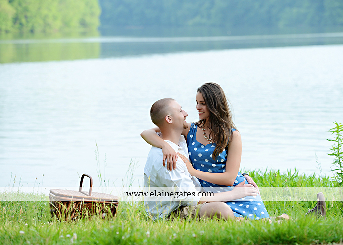 Mechanicsburg Central PA portrait photographer engagement outdoor couple water trees grass field dock water lake fishing lure boat holding hands picnic basket kiss path ph 16