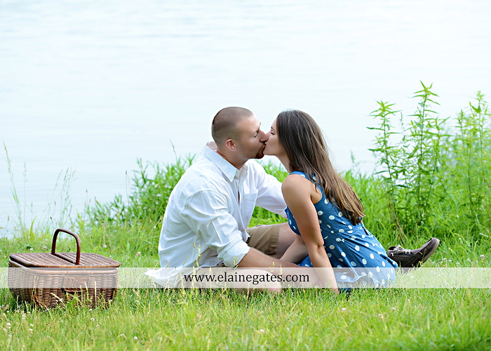 Mechanicsburg Central PA portrait photographer engagement outdoor couple water trees grass field dock water lake fishing lure boat holding hands picnic basket kiss path ph 17