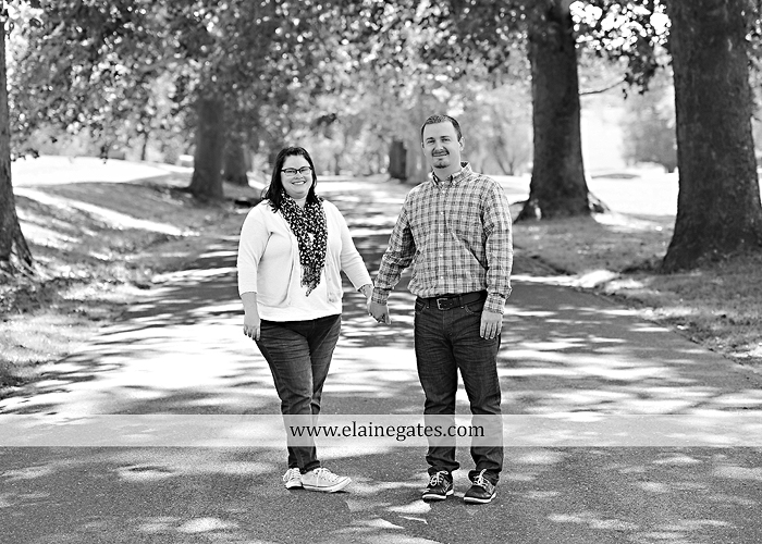 Mechanicsburg Central PA engagement portrait photographer outdoor road trees field hay bale fence water stream creek couple kiss hug holding hands ce 02