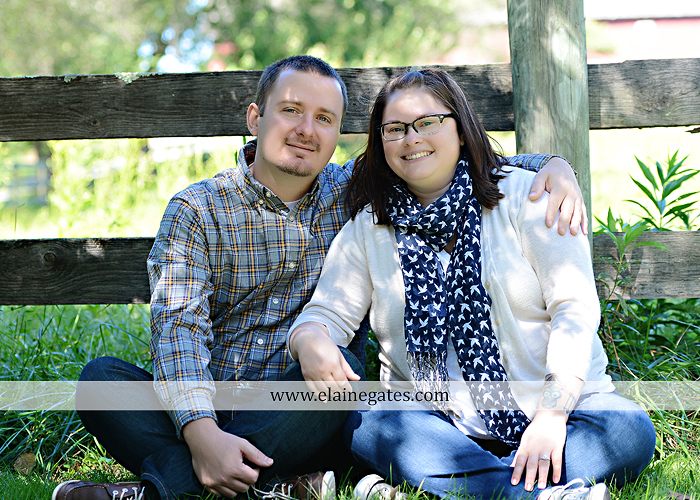 Mechanicsburg Central PA engagement portrait photographer outdoor road trees field hay bale fence water stream creek couple kiss hug holding hands ce 05