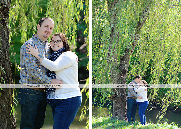 Mechanicsburg Central PA engagement portrait photographer outdoor road trees field hay bale fence water stream creek couple kiss hug holding hands ce 06