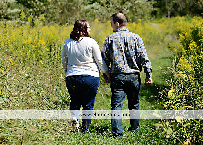 Mechanicsburg Central PA engagement portrait photographer outdoor road trees field hay bale fence water stream creek couple kiss hug holding hands ce 07