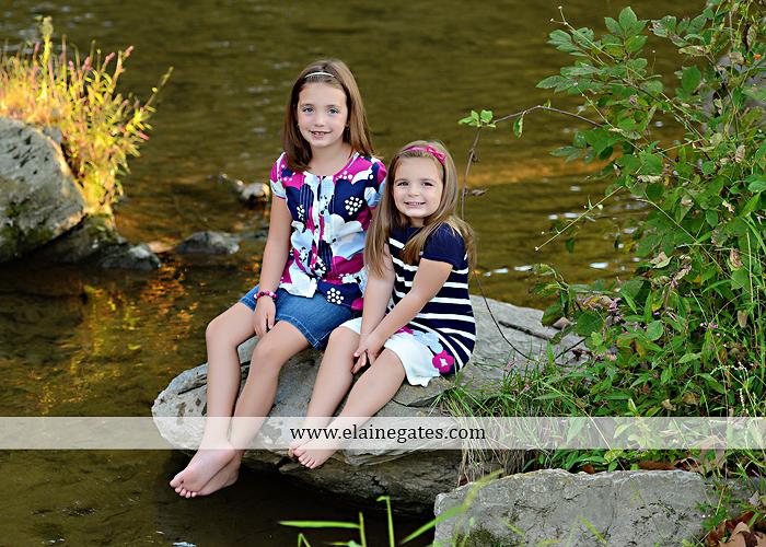 Mechanicsburg Central PA kids children portrait photographer outdoor girls sisters fence grass field trees water stream creek rocks road hay bail sh 08