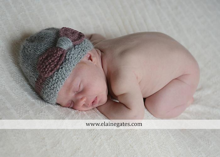 Mechanicsburg Central PA newborn baby portrait photographer girl sleeping indoor blanket bow basket tutu knit hat grass ns 07