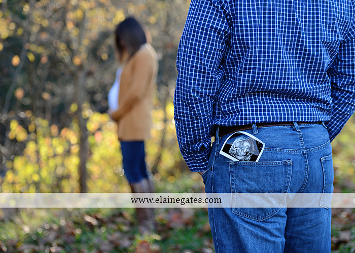 Mechanicsburg Central PA portrait photographer maternity outdoor path trees grass water stream creek kiss holding hands pillow sonogram belly rings jm 4