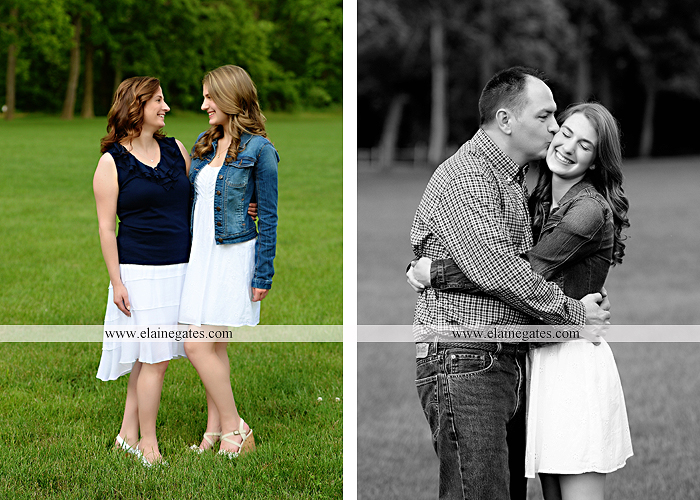Mechanicsburg Central PA family portrait photographer outdoor children daughters sisters mother father grass trees road wheelchair hug kiss dk 01