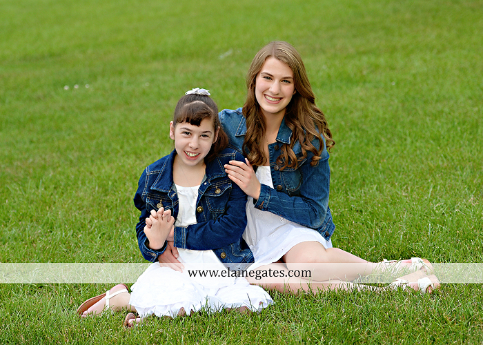 Mechanicsburg Central PA family portrait photographer outdoor children daughters sisters mother father grass trees road wheelchair hug kiss dk 03