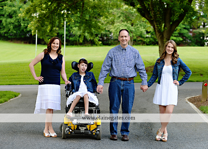 Mechanicsburg Central PA family portrait photographer outdoor children daughters sisters mother father grass trees road wheelchair hug kiss dk 06