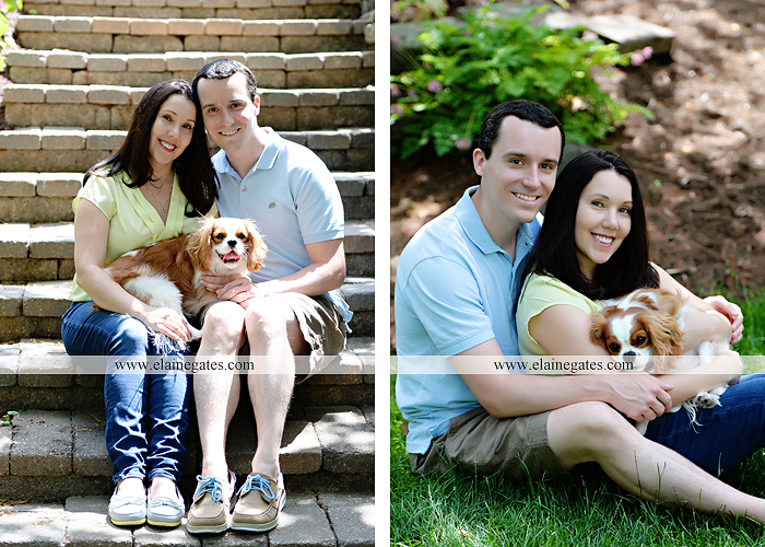 Mechanicsburg Central PA engagement portrait photographer hotel hershey outdoor steps stairs dog grass stone wall pillars hug kiss holding hands fountain water indoor balcony nr 01