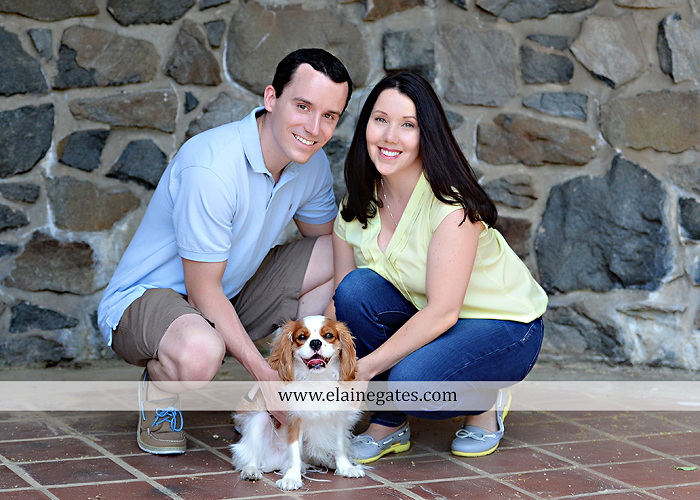 Mechanicsburg Central PA engagement portrait photographer hotel hershey outdoor steps stairs dog grass stone wall pillars hug kiss holding hands fountain water indoor balcony nr 04