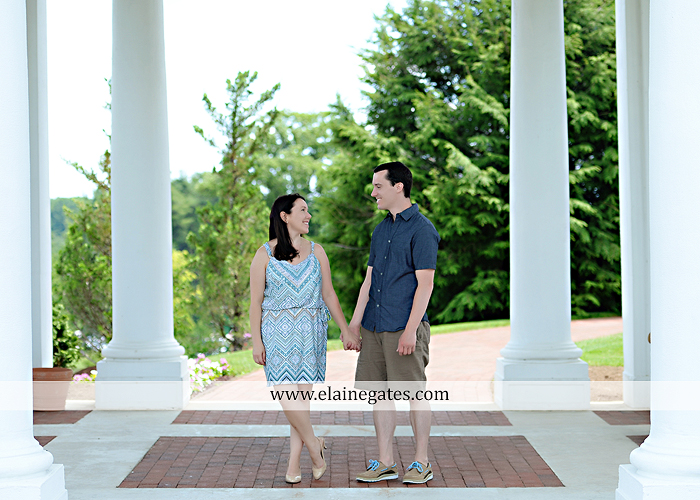 Mechanicsburg Central PA engagement portrait photographer hotel hershey outdoor steps stairs dog grass stone wall pillars hug kiss holding hands fountain water indoor balcony nr 06