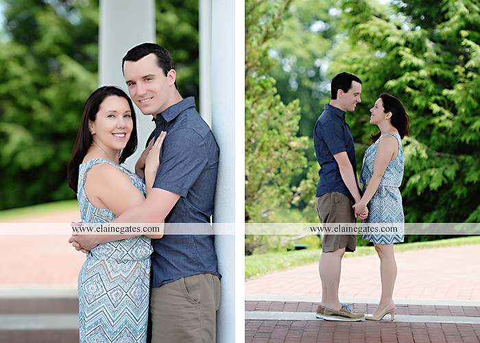 Mechanicsburg Central PA engagement portrait photographer hotel hershey outdoor steps stairs dog grass stone wall pillars hug kiss holding hands fountain water indoor balcony nr 09