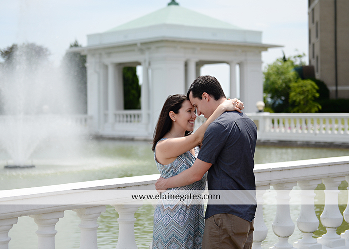 Mechanicsburg Central PA engagement portrait photographer hotel hershey outdoor steps stairs dog grass stone wall pillars hug kiss holding hands fountain water indoor balcony nr 10