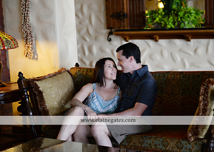 Mechanicsburg Central PA engagement portrait photographer hotel hershey outdoor steps stairs dog grass stone wall pillars hug kiss holding hands fountain water indoor balcony nr 14
