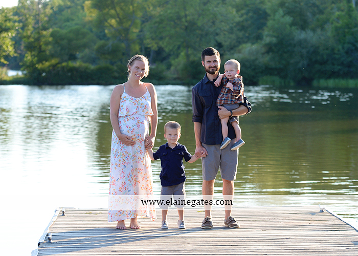 mechanicsburg-central-pa-portrait-photographer-maternity-outdoor-mother-father-sons-field-water-lake-dock-path-canoe-hug-kiss-baby-bump-nk-03