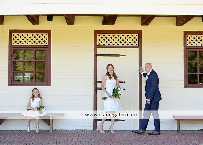 mechanicsburg-central-pa-wedding-photographer-water-shore-trees-church-road-sign-flowers-roses-husband-wife-daughter-kiss-holding-hands-station-covered-bridge-marriage-rings-couple-love-sj-10