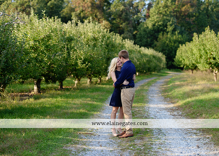 mechanicsburg-central-pa-engagement-portrait-photographer-outdoor-couple-orchard-road-path-trees-holding-hands-kiss-hug-love-barn-field-wildflowers-ls-01